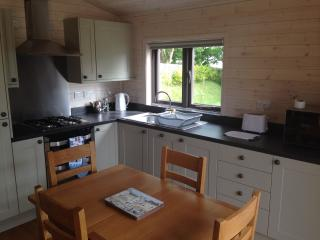 Fully fitted kitchen with dishwasher, fridge-freezer, gas hob and oven, microwave etc