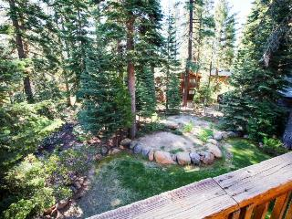 Sit out on the deck with your dog or soak in the private hot tub at this home!