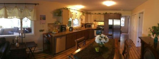 Kitchen has stainless steel applicances and all kitchen necessities, pot, glasses, utencils