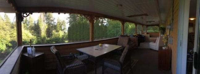Fully screened deck is a great spot to share meals and entertain