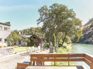 Dog-friendly riverfront home w/perfect views, shared deck & close beach access!