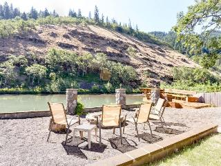Dog-friendly riverside retreat w/ water views & outdoor deck!