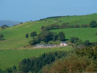 Two 5 star holiday cottages and the owners's farmhouse in a lovely setting. Photo by Storm Developme