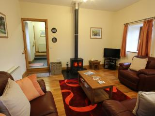Inviting living area with freeview TV, DVD and wood burner