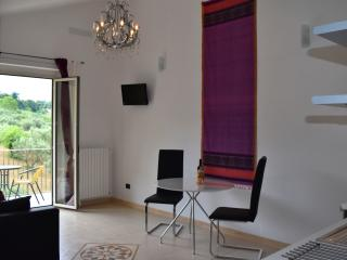 La Majella Apartment living area with access to private use balcony.