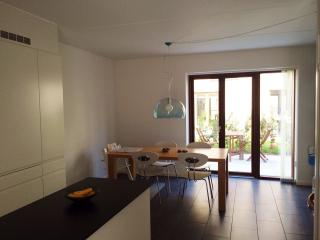 Cozy and spacious combined kitchen and dining area on ground floorwith entrance to the back garden.