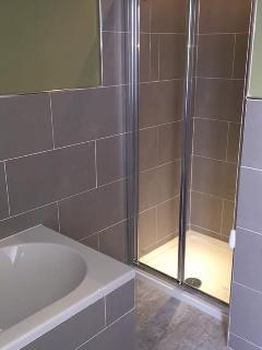 Spacious shower enclosure