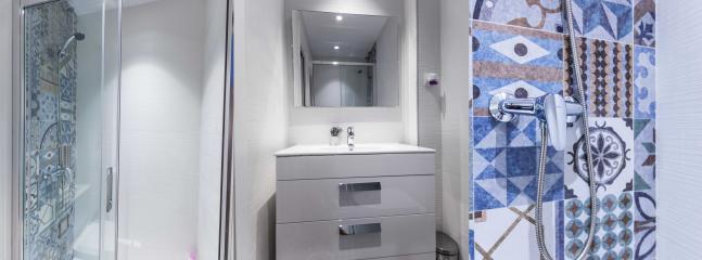 Stylishly renovated second bathroom.