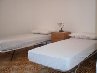 camera da letto con terrazzino vista mare