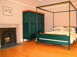 Bedroom 1 with a four poster kingsize bed and a real fireplace