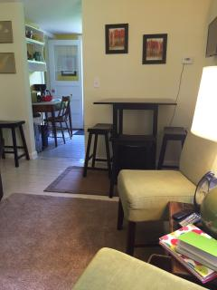 Pub Height table and seating for 4, plus flat screen TV with Cable, WiFi and Amazon Fire TV Stick.