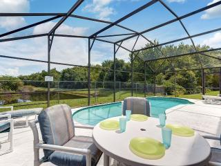 Spacious 4-bed lakeside pool villa near Disney