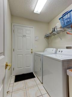 The air conditioned utlity room has all you need ( washer, drier, iron, ironing board)