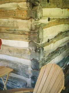 hand hewn logs form main part of cabin