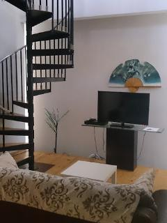 Flat screen TV and spiral staircase