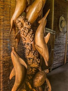 Carved dolphins at entryway