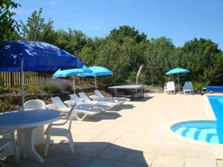 Pool terrace with sunloungers, parasols, table tennis table and solar shower