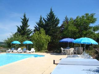 Peaceful pool terrace with sunloungers, parasols, pool table and solar shower