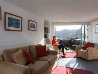 The living room has a terrace overlooking Bouley Bay.
