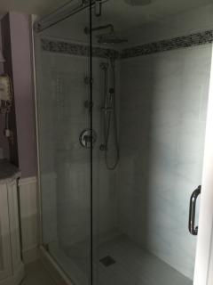 oversized shower in bathroom with king bedroom