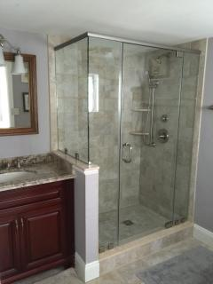 another large bathroom that is attached to a king bedroom