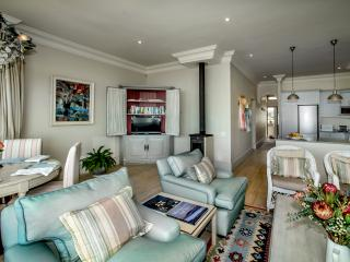 The living area is spacious and easy on the eye. Soft, beachy colours, full cable TV and wifi.