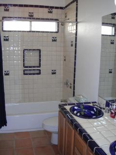 Main bathroom with tub/shower & double hand-painted Spanish sinks.