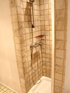 The shower is inside the bathroom