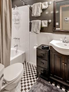 The bathroom features a nice tub/shower combo