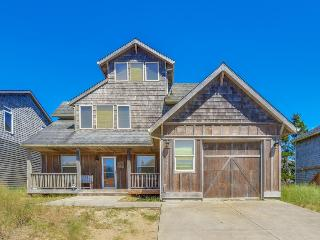 Spacious home w/ a private hot tub & ocean views, one block to the beach!
