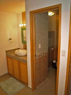 Second bedroom vanity and bath.  Each bedroom has a large shower.