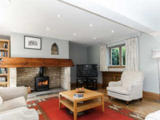 Sitting room with open fire and comfortable seating
