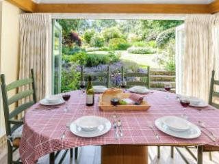 Dining table and chairs with folding glass doors which open onto the patio