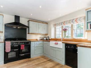 A well equipped kitchen with all modern appliances and a fridge / freezer
