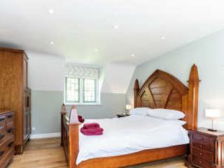 Double bedroom with gothic style craftsman made bed