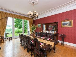 Large bright dining room can seat up to 14, comfortably 12.