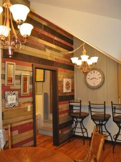 Dining room w additional lighting and reclaimed wood wall