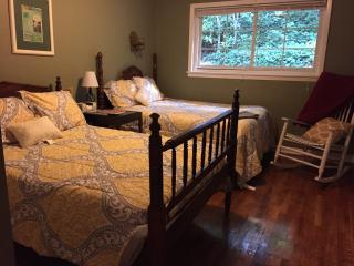 Bedroom 2, TWO full-sized beds, lots of pillows,  closet, , desk, rocking chair,