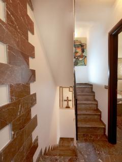 Stair case to the bed room nr. 2 with marble floor tiles