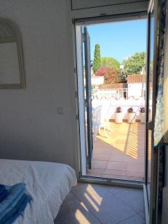Bedroom 2 overlooking private terrace