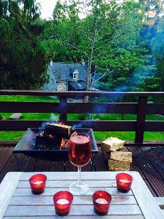 Enjoy a nice glass of wine by the fire pit on the Top Deck of an evening