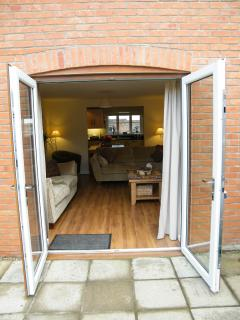 Large patio doors leading from the garden into the lounge