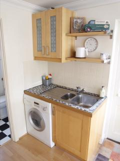 Kitchen showing washer/dryer