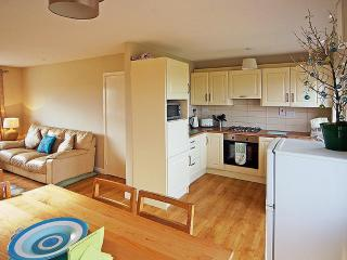 Kitchen has gas hob, extractor, electric oven, fridge with separate freezer & microwave