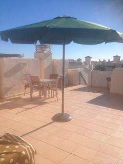 Large solarium enjoying panoramic views to the Mar Menor, golf course and mountains.