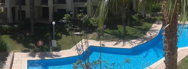 Beautiful view of the pool from the lower balcony at breakfast time.