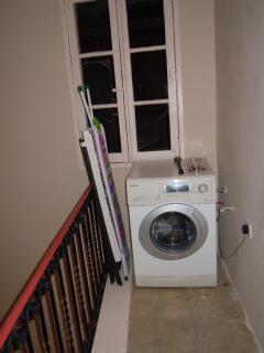 Automatic washing macgine shared between the three studio Apts