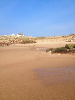 Pristine sands with the cottages in the background