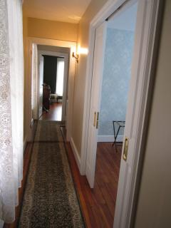 Upstairs Hallway leading to bedrooms...Warm and Charming!