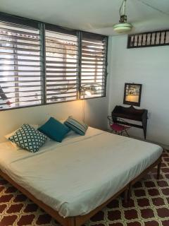 The main room have a king size bed, private patio, bathroom and  kitchenette .